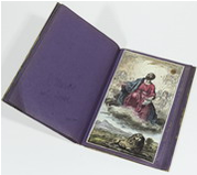 Un volume proveniente dalla collezione di Francesco Novati, con le pagine di supporto blu